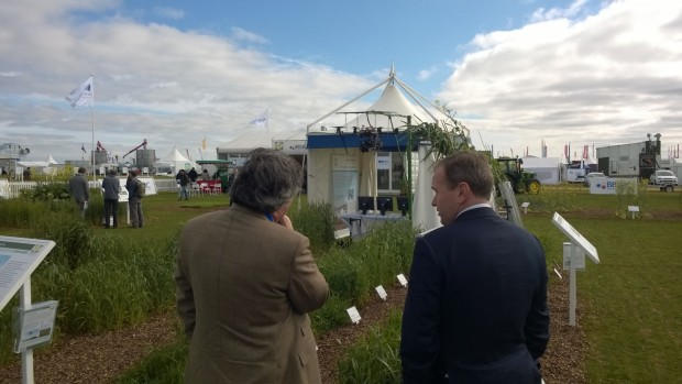 Farming Minister George Eustice talks to Professor Malcolm Hawksford, from Rothamsted Research at Cereals 2015