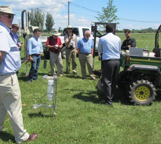 Paricipants of the 2014 UK-Canada workshop in precision agriculture observing automated equipment developed at McGill University.